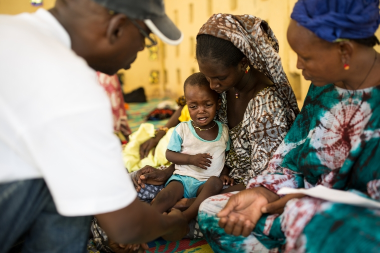 Ousmane sits on his mother's lap at the Nutrition Center in Selibaby Hospital, Mauritania.
